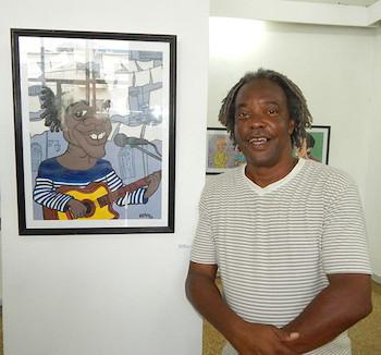 Gerardo Alfonso junto a su caricatura